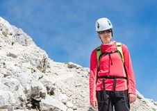 Female climber posing on a mountain path Royalty Free Stock Image
