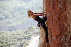 Female climber prepearing to the next move Royalty Free Stock Images