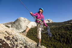 Female climber rappellling. Stock Photography