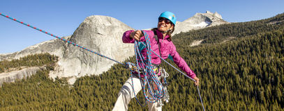 Female climber rappellling. Royalty Free Stock Photography