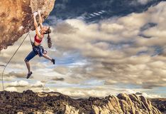 Climber on the edge. Royalty Free Stock Photo