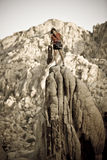 Female climber on the summit. Stock Photo