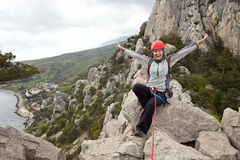 Female climber at the top of the route Stock Photography