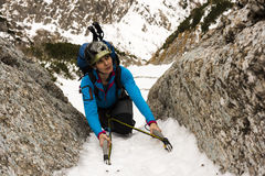 Female Climber on a winter ascent of the mountain Stock Photo