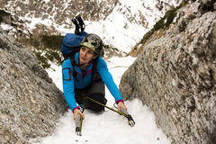 Female Climber on a winter ascent of the mountain Stock Images