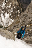 Female Climber on a winter ascent of the mountain Stock Image