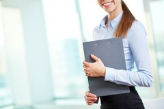 Female with clipboard Royalty Free Stock Image