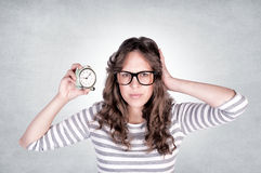 Female with clock Stock Images