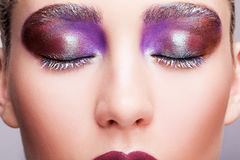 Female closed eye with evening violet eyes shadows, white eyelas Royalty Free Stock Photos