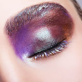 Female closed eye with evening violet purple eyes shadows and wh Stock Image