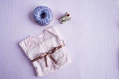 Female clothes and accessories for the newborn Stock Photos