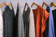 Female clothes hanging on a clothing rack in a shop or home clos. Clothing hanging on a clothing rack in a shop or home closet Royalty Free Stock Image