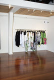 Female clothes hanging on rack in fashion boutique Stock Photography