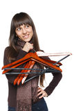 Female with clothing hangers Royalty Free Stock Photos