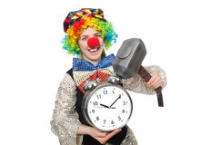 Female clown with alarm-clock and hammer isolated Royalty Free Stock Photography