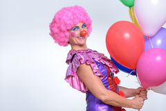 Female Clown with Balloons Smiling at the Camera Royalty Free Stock Photo