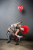 Female clown bent over backwards Stock Photo