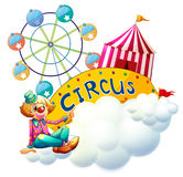 A female clown beside the circus signboard Royalty Free Stock Photos