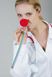 Female clown doctor with red nose Stock Images