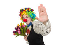Female clown with flowers isolated on white Royalty Free Stock Photo