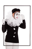 Female clown in a frame is crying Royalty Free Stock Photos