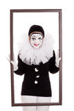 Female clown in a frame is looking angry Stock Photo