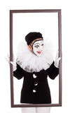 A female clown in a frame is looking angry Royalty Free Stock Image