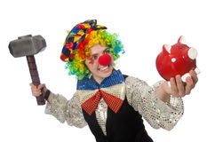 Female clown with hammer. The female clown with hammer and moneybox isolated on white Royalty Free Stock Image