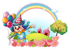A female clown at the hill with a rainbow Royalty Free Stock Images