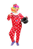 Female clown holding a magician hat Royalty Free Stock Photo