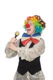 Female clown with maracas isolated on white Stock Photos