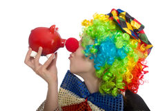Female clown with moneybox isolated on white Stock Image