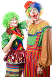 Female clown punching clown. Isolated on white Stock Photos