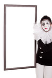 Female clown shows an empty frame Royalty Free Stock Photo