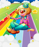 A female clown sitting at the colorful road Royalty Free Stock Photo