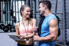 Female coach discussing with a muscular man Royalty Free Stock Photo