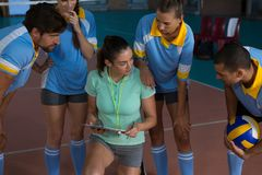 Coach having conversation with volleyball players Royalty Free Stock Image