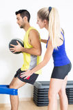 Female coach helping with exercise Stock Image