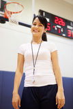 Female Coach Of High School Basketball Team Royalty Free Stock Image