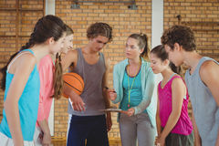 Female coach mentoring high school kids stock photos