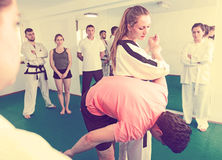 Female coach showing painful hold Stock Image
