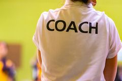 Female coaches in white COACH shirt stock images