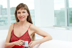 Female with coffee Stock Images