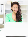 Female colleague with laptop Stock Image