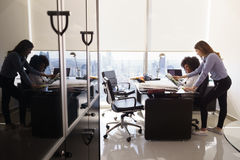 Female Colleagues Architect Using Tablet PC In Office Royalty Free Stock Image