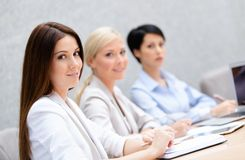 Female colleagues discuss business plan. Sitting at the meeting hall. Leadership team Stock Photos