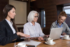 Female colleagues enjoying work together Royalty Free Stock Photo