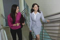 Female Colleagues Moving Up On Stairway Royalty Free Stock Photos