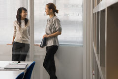 Female colleagues in office Stock Photography