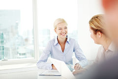 Female colleagues in office Stock Image